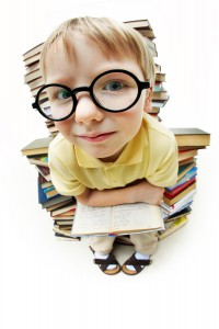 child sitting on books / skills
